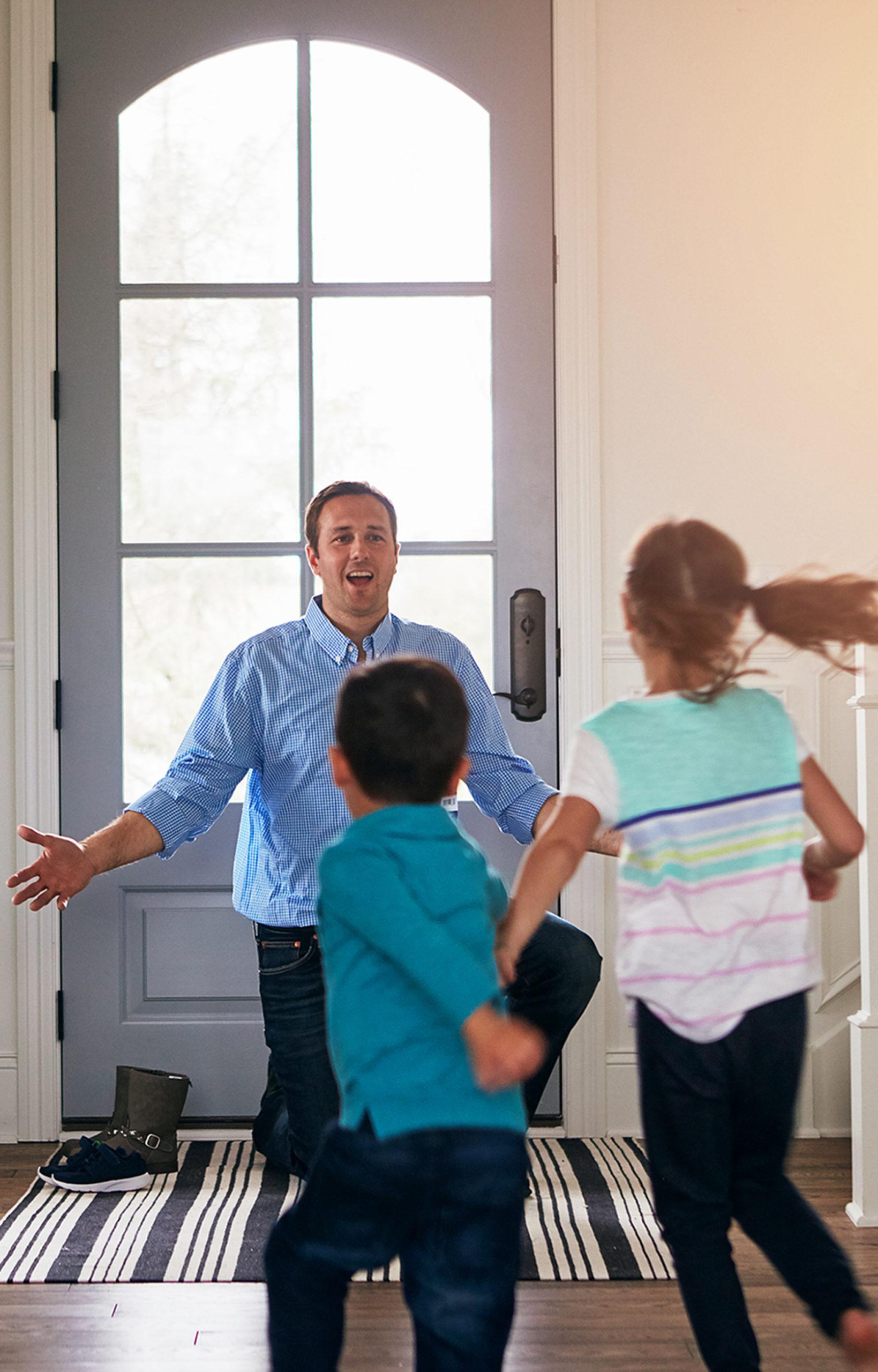 Kids running to Dad
